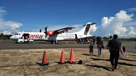 KOLAKA, INDONESIA - January 10, 2019: Passengers who want to board a plane at Kolaka Nibandera Sangia Airport before pandemic Covid-19.