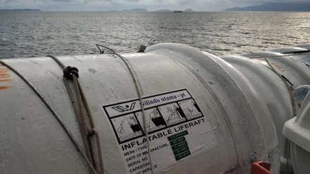 KOLAKA, INDONESIA - December 28, 2018: Inflatable liferaft safety equipment on one of the ferries in Kolaka