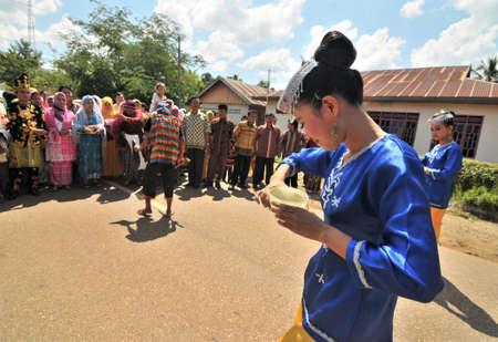 Kolaka, Indonesia - November 16, 2011: Traditional dancers when welcoming a bridegroom to a wedding