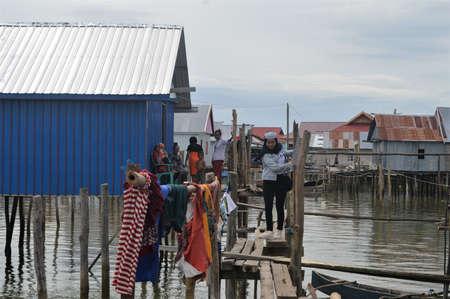 Pomalaa, Indonesia - July 3, 2020: Bajau tribal houses on the beach in Hakatutobu, Pomalaa, Southeast Sulawesi Indonesia
