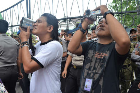 Kolaka, Indonesia - November 14, 2011: Television journalists when taking a moment