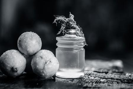 Citrus × limon,Lemon with lemon oil in a transparent bottle.Concept of skin,beauty and care.