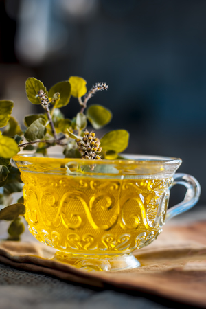 Tea cup with leaves as background