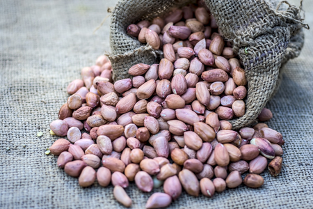 Raw Arachis hypogaea,peanut in a gunny bag. Stock Photo