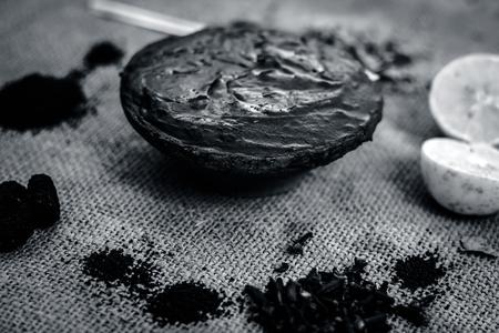 Henna,Lawsonia inermis paste with natural ingredients i.e. lemon,citrus × limon,Indian iliac,azadirachta indica,neem paste with coffea,coffee powder.
