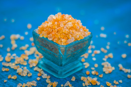 Close up of Edible gum,Gond,acacia gum in a blue colored bowl. Stock Photo