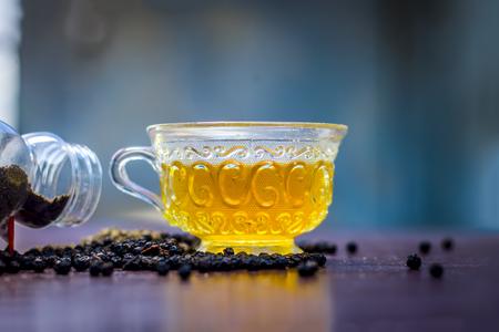 Close up of tea of Black pepper,Piper nigrum with raw black pepper and powder.