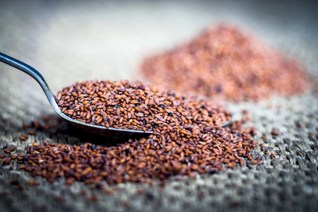 Close up of Flax seeds,asalya,Linum usitatissimum in a spoon on a gunny bag.