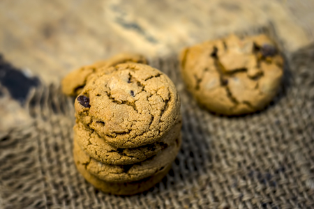 Homemade freshly baked chocolate chip cookies on gunny background.; Stock Photo