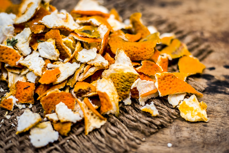 Close up of dried peel of orange,Citrus aurantium on a gunny background used as a face pack and for skin care.