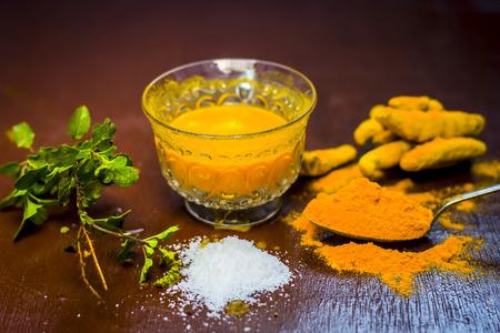 Tea  of turmeric,Curcuma longa,Haldi, Ajwain,Trachyspermum ammi and salt,Sodium Chloride.;