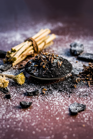 Mixture or ingredients of the traditional toothpaste made in Asia i.e. Coal powder, powder of neem bush, clove, and salt, sodium chloride. Stock Photo