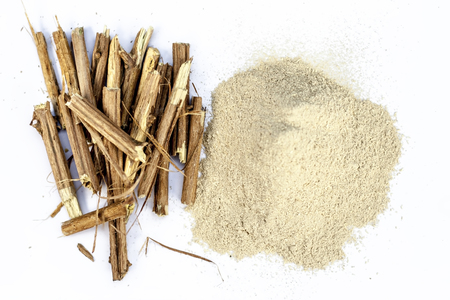 Ashwagandha roots and its powder also known as Indian ginseng, isolated on white essential beneficial for hair loss,