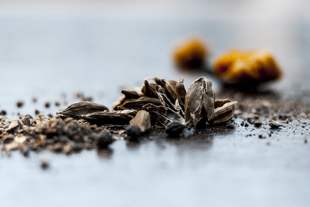 Close up of Green Cardamom and Jaggery. Stock Photo