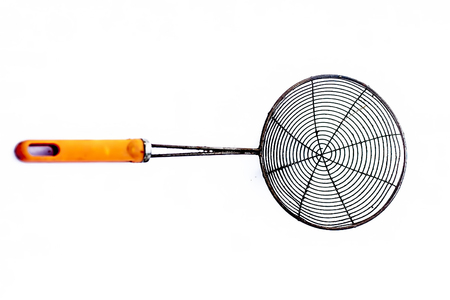 Deep frying strainer isolated on white with a orange handle.