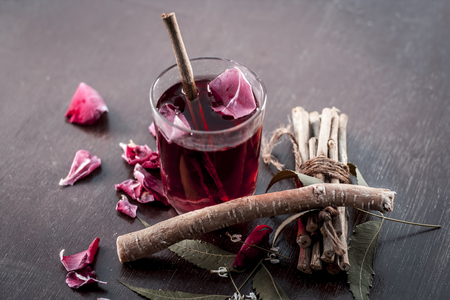 Indian Ayurvedic and Islamic way of doing brush with using miswak or Neem bark with rose water on wooden surface in dark Gothic colors. Stock Photo