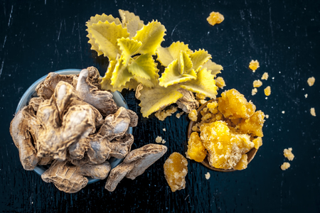 Dried ginger or Zingiber officinale or Soth,Sonth with ayurvedic medicinal herb Ajwain or Bishop's weed or caram with jaggery it helps in morning sickness, antibiotic herb, helps to fight cancer etc. Stock Photo