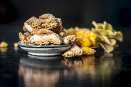 Dried ginger or Zingiber officinale or Soth,Sonth with ayurvedic medicinal herb Ajwain or Bishop's weed or caram with jaggery it helps in morning sickness, antibiotic herb, helps to fight cancer etc.