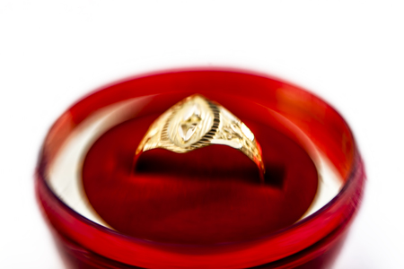 Gold ring in a red box isolated on white. Stock Photo