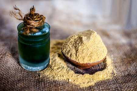 Close up of  powder of ayurvedic herbs Triphala a mixture especially used in hair care to have long and silky smooth hairs with its extract beneficial oil. Banco de Imagens