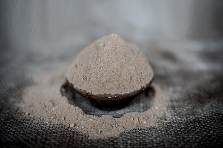 Close up of  powder of ayurvedic herbs Triphala a mixture especially used in hair care to have long and silky smooth hairs. Imagens