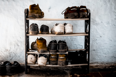 Shoe rack  or Shoe cabinet with some shoes and shocks. Stock Photo