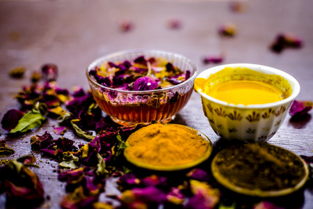 Close up of face pack of chandan or sandalwood i.e. Rose water with turmeric and sandalwood powder.