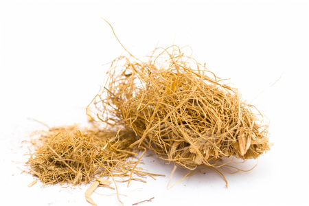 Close up of raw khus or vetiver grass a herbal root with full of aroma used in many Indian and Asian beverages isolated on white. Stock Photo