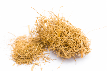 Close up of raw khus or vetiver grass a herbal root with full of aroma used in many Indian and Asian beverages isolated on white. Imagens