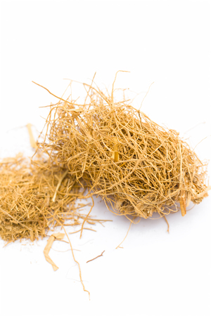 Close up of raw khus or vetiver grass a herbal root with full of aroma used in many Indian and Asian beverages isolated on white.