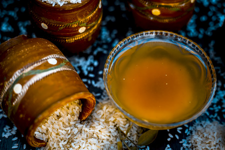 Close up of ayurvedic home remedy for smooth and thick hair i.e. rice water on wooden surface.