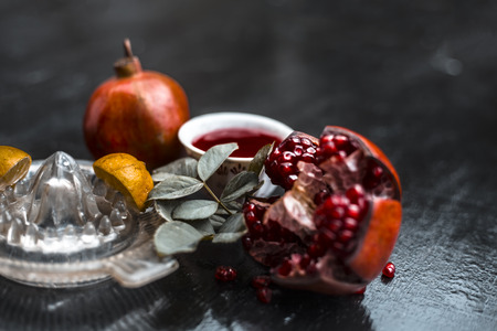 Close up of herbal and organic face pack of pomegranate with lemon juice on wooden surface for Sun tanning. Stok Fotoğraf