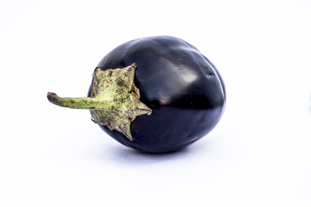 Close up of fresh organic egg plant or bringal or Aubergines or brinjal or baingan or eggplant isolated on white.