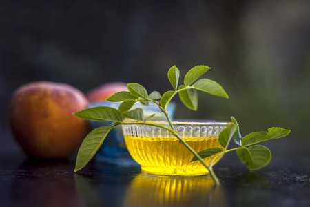 Close up of face pack of apple i.e. apple pulp mixed with honey to normalize skin which becomes dry in winter on wooden surface. Stock Photo