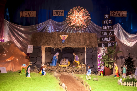 Close up of decorative house made of Jesus Christ with mother marry on Holy day of Christmas.
