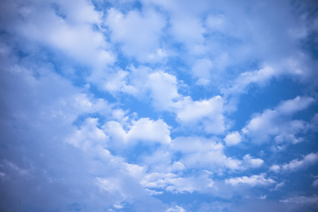 Close up of white and black colored clouds in the blue sky. Фото со стока - 124596299