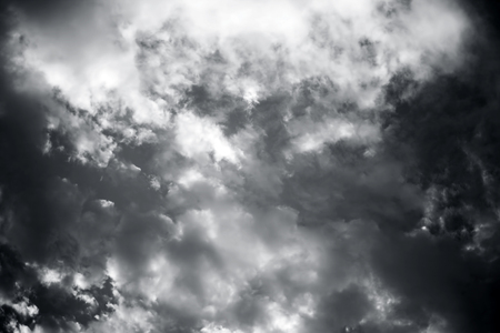 Close up of white and black colored clouds in the blue sky. Reklamní fotografie