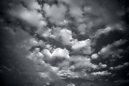 Close up of white and black colored clouds in the blue sky. Imagens - 124596332