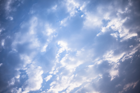 Close up of white and black colored clouds in the blue sky. Фото со стока - 124596340