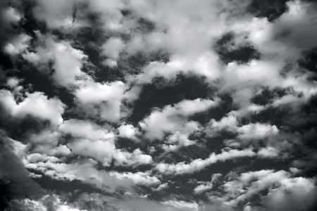 Close up of white and black colored clouds in the blue sky. Фото со стока - 124596345