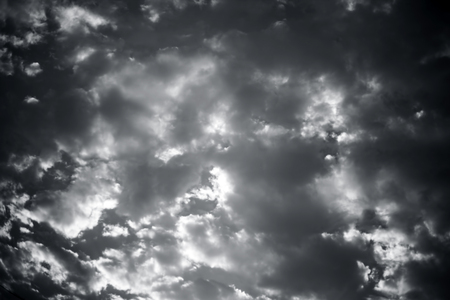 Close up of white and black colored clouds in the blue sky. Фото со стока - 124596369