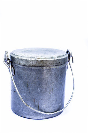 Close up of aluminum milk pot or canister isolated on white.
