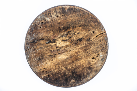 Close up of brown colored textured circular wooden piece isolated on white. Stok Fotoğraf