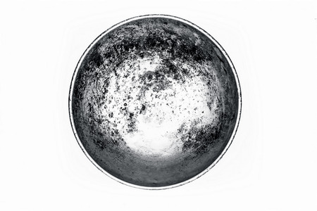 Close up of silver colored empty woks or rounded pan or karahi or kadahi isolated on white widely used in Asia for frying purposes.