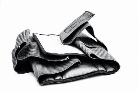 Close up of medical heat waist belt for lower back pain or back pain isolated on white used by both men and women. Stock Photo