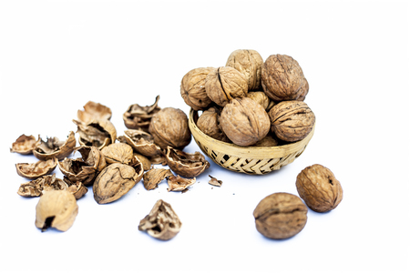 Close up of raw organic Walnut or Juglans or Akhrot or Akharot isolated on white in a hamper without shell on surface. Stock Photo - 122952857