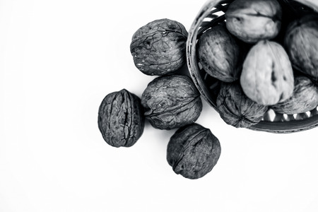 Close up of raw organic Walnut or Juglans or Akhrot or Akharot isolated on white in a hamper.