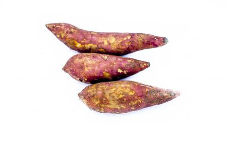 Root vegetable isolated on white i.e. Sweet potato or shakarakand or Ipomoea batatas or yam.