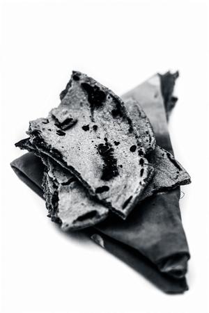 Bajri ki roti or pearl millet roti or chapati  on handkerchief isolated on white.