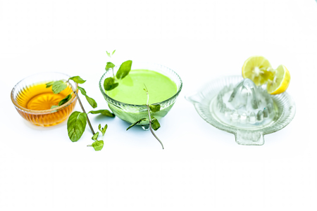 Close up of face pack of mint leaves with honey and lemon juice isolated on white used fade acne scars and blemishes.